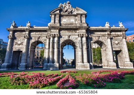 "The Puerta de Alcala is a monument in the Plaza de la Independencia (""Independence Square"") in Madrid, Spain.  It was commissioned by King Carlos III, with construction beginning in 1778. - stock photo"