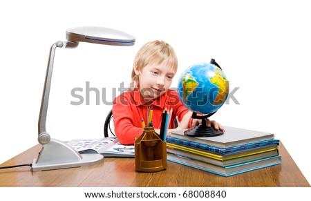 The pupil looks at the globe - stock photo