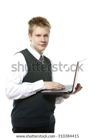 the pupil of high classes in a school uniform with a notebook  - stock photo