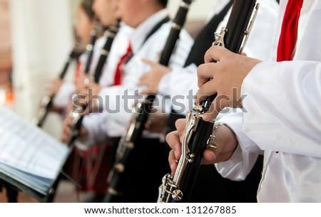 The pupils playing the clarinet. - stock photo