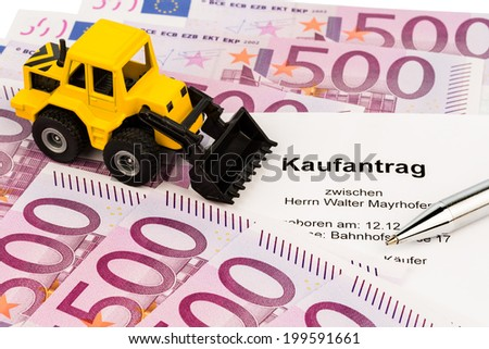 the purchase contract for a new excavator. with euro money and pen - stock photo