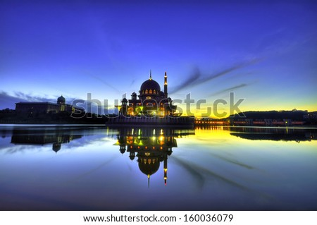 The Putra Mosque silhouette, in Putrajaya, Malaysia in the morning hours - stock photo