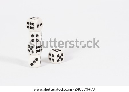 The pyramid of dice left/ Dice on white background - stock photo