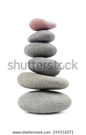 The pyramid of pebbles. Isolated on white background