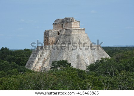 The Pyramid of the Magician, Uxmal, Yucatan Peninsula, Mexico. The Adivino (the Pyramid of the Magician or the Pyramid of the Dwarf), Uxmal, Yucatan, Mexico. View from Governor's Palace. - stock photo