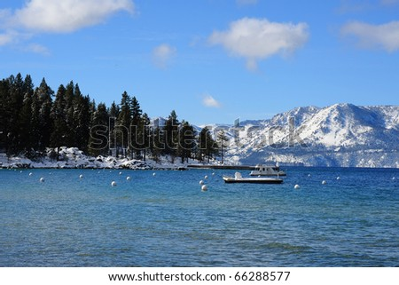 The Pyramid Peak and Mount Price mountain in lake tahoe beach in winter - stock photo