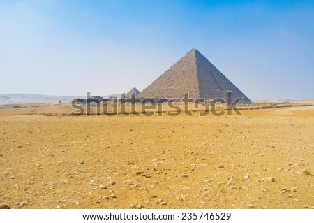 The Pyramids of Giza are the most notable landmarks, built in desert, Egypt.