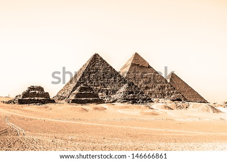 The pyramids of Giza, Cairo, Egypt;  the oldest of the Seven Wonders of the Ancient World, and the only one to remain largely intact. - stock photo