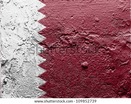 The Qatari flag painted on grunge wall - stock photo