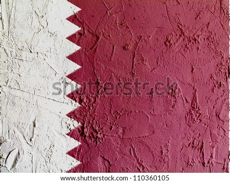 The Qatari flag painted on wall - stock photo