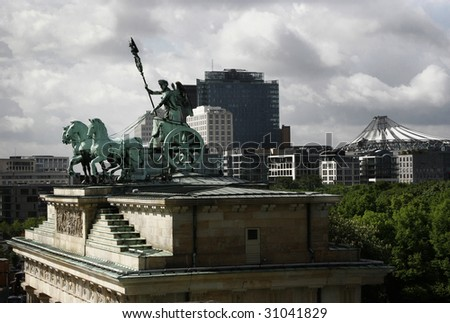 The Quadriga on the Brandenburger Tor and in the background the Tiergarten and the Potsdamer Platz, Berlin, Germany - stock photo