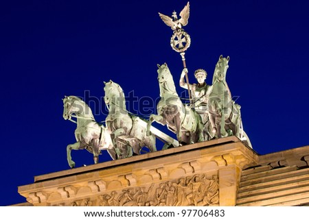 The Quadriga on top of the Brandenburger Tor at night - stock photo