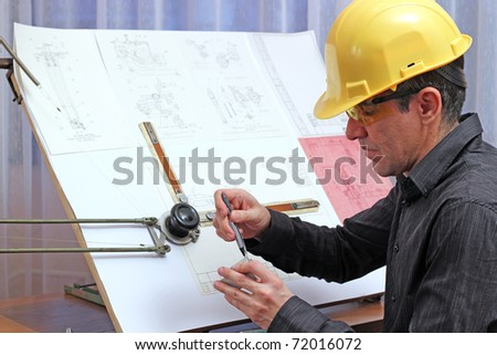 The quality dimensional inspector/engineer checking metal components. - stock photo