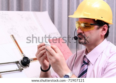 The quality dimensional inspector/engineer discussing his inspection results, over the phone connection. - stock photo