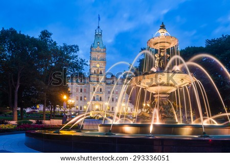 The Quebec Parliament Building and the Fontaine de Tourny at twilight in Quebec City, Quebec, Canada. - stock photo