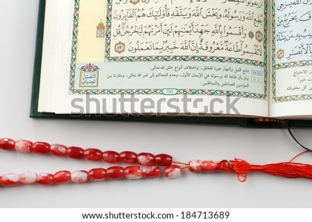 "The Quran literally meaning ""the recitation"", is the central religious text of Islam, which Muslims believe to be a revelation from God or Allah - stock photo"