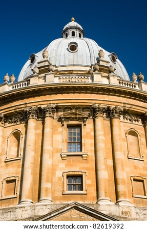 The Radcliffe Camera reading room of Oxford University's Bodleian Library against a deep blue sky - stock photo