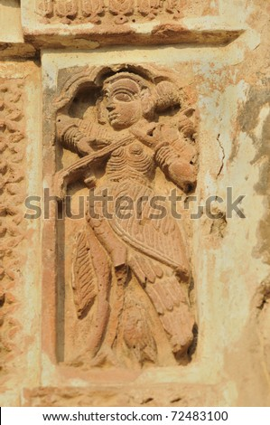 The Radha Gobinodo temple in Jaydev -Kenduli in Birbhum District of the West Bengal State in India has exquisite terracotta carvings. This part of the temple shows a woman playing music.
