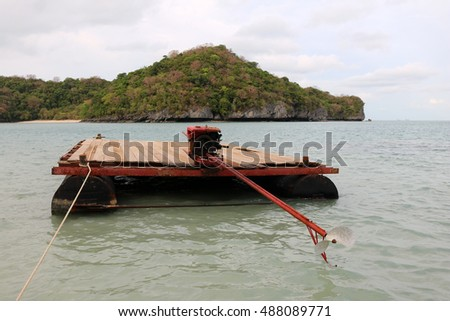 The raft with long-tail boats engine to transport materials in Thailand.