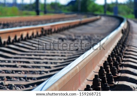 The railroad turns. - stock photo