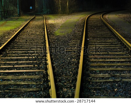 The railway / rails, a branching - night landscape - stock photo