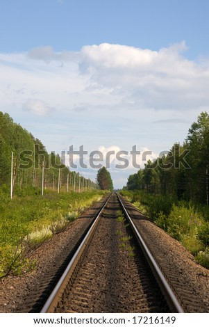 The railway, trees along it and the sky