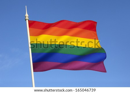 The rainbow flag or gay pride flag, is a symbol of lesbian, gay, bisexual, and transgender pride. It originated in California, but is now used worldwide. - stock photo