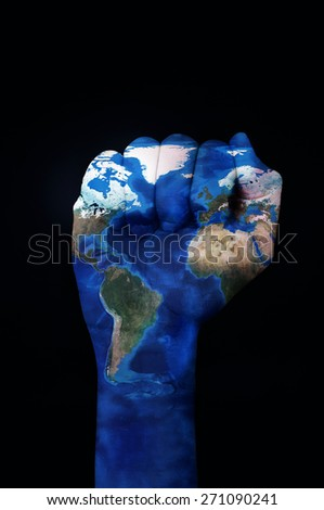 the raised fist of a young man patterned with a world map (furnished by NASA) on a black background depicting the concept of the ecologist movement or the empowerment of the ecologism - stock photo