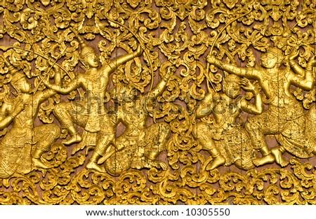 The ramayana epic carved on a wood door inside a temple. Luang Prabang, Laos. - stock photo