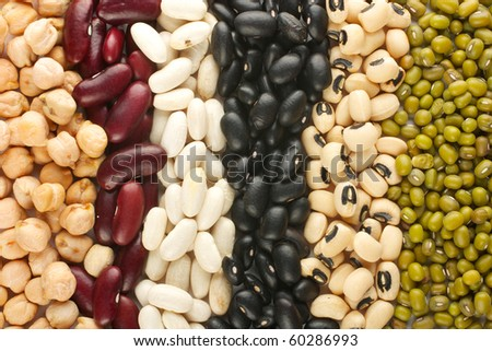 The ranks of different beans: kidney, mung, chickpea, black eye, preto. View from above.