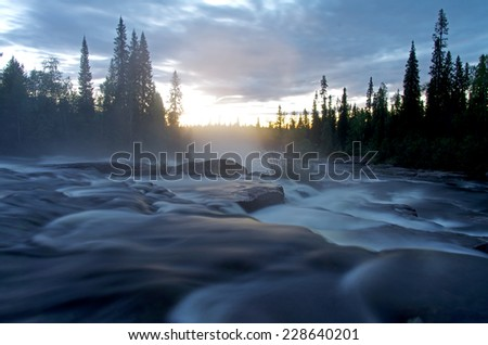 """The rapid  of """"Waterfall"""" - the last rapid on the river Kutsayoki before it flows into the Tumcha (Russia, Murmansk region). White night, the end of July. - stock photo"""
