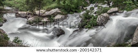 The rapids of the river at the foot of the waterfall Toce, Formazza Valley - Piedmont, Italy