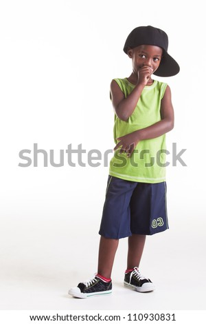 The rapper child in the studio with his rap clothes. - stock photo
