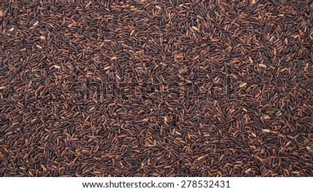 The raw black jasmine rice texture for background.