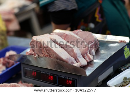 The raw pork on a scale in market - stock photo