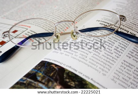 The reading glasses on a magazine.