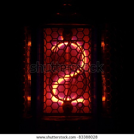 The real Nixie tube indicator of the numbers of retro style. Indicator glow with a magical purple fringing. Digit 2 - stock photo