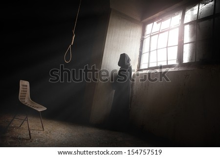 The reaper Waiting a despair man in an abandoned place with a Hangman Noose - stock photo