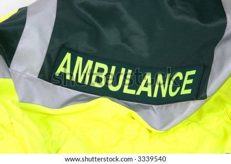 The rear of an Ambulance drivers high visibility jacket - stock photo