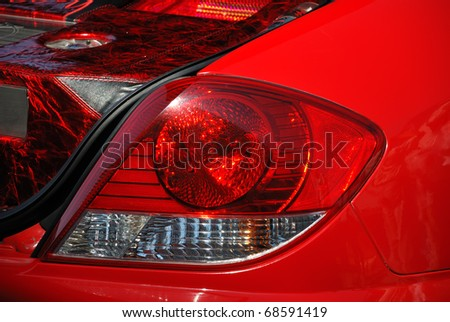 The rear view of the red custom car - stock photo