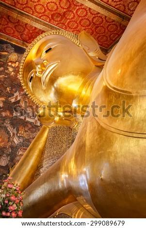 The Reclining Buddha at Wat Pho (Pho Temple) in Bangkok, Thailand   - stock photo