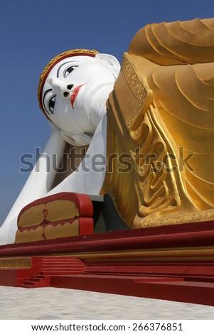 The Reclining Buddha next to the Laykyun Sekkya Standing Buddha near Monywa in Myanmar (Burma). - stock photo