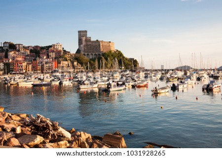 The recreational harbour and skyline  of Lerici at sunset in the La Spezia province of the Liguria region in northern Italy