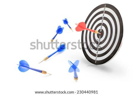The red arrow achieved hit center Target of dart board with blue darts miss and failure isolated on white background.  - stock photo