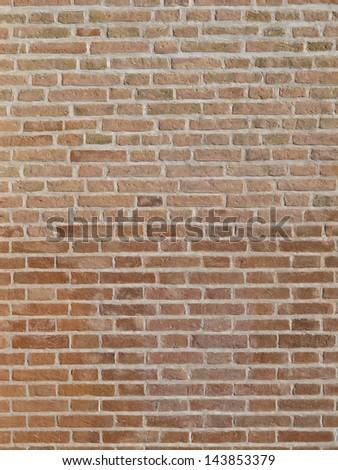The red brick wall of a building - stock photo