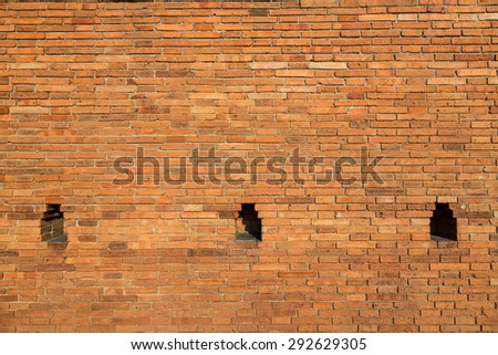 The red brick wall with lantern or candle place.