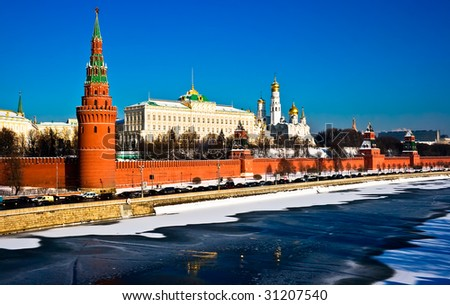 The red brick walls of famous Kremlin in Moscow with its churches - stock photo