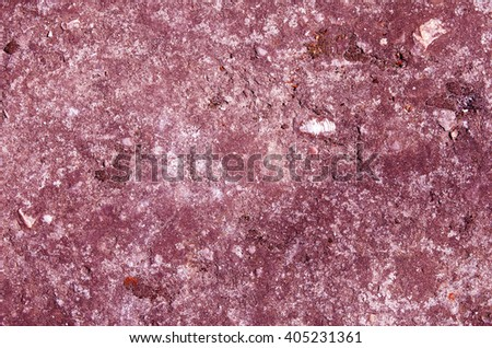 The red concrete wall with traces of moss and small stones. textural composition - stock photo