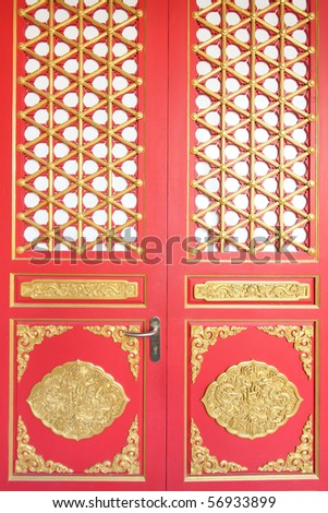 The red door with gold texture in chinese style. - stock photo