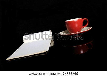 The red espresso cup and the notepad - stock photo